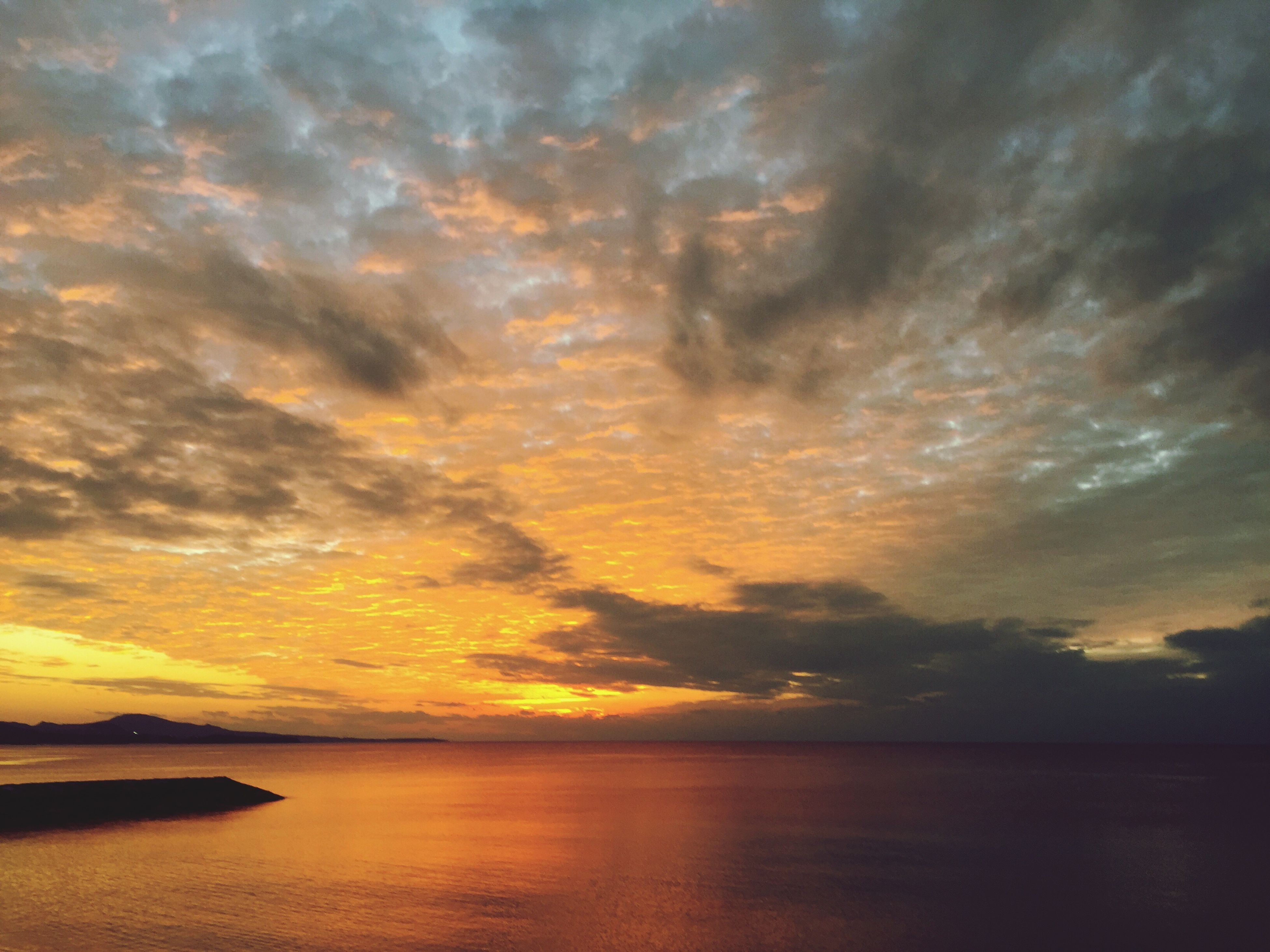 sunset, scenics, tranquil scene, water, sky, tranquility, beauty in nature, sea, cloud - sky, waterfront, idyllic, nature, orange color, horizon over water, cloud, cloudy, reflection, outdoors, dramatic sky, no people