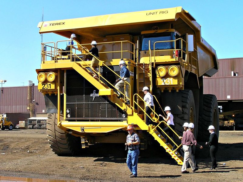 Dump Truck: Iron ore, Taconite Trucking Dump Truck Iron Ore Huge Mining Industry Machinery