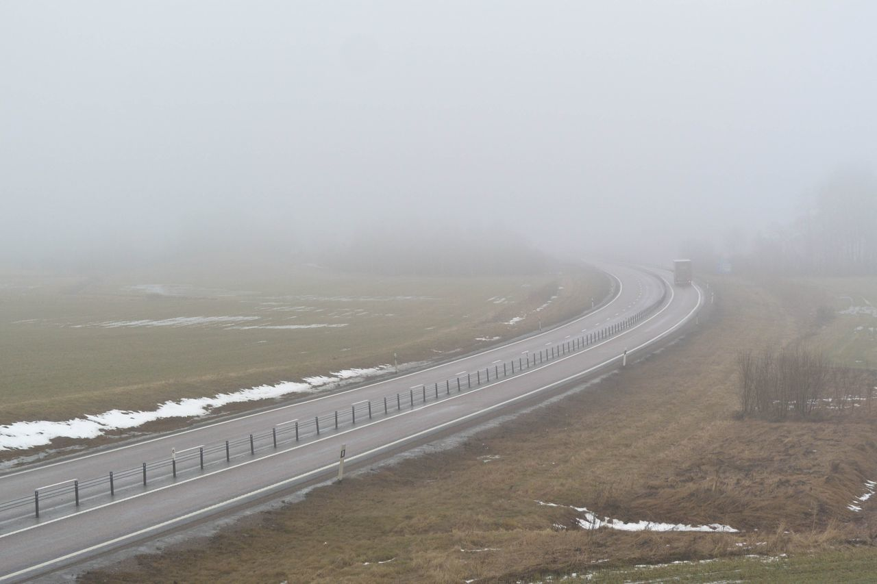 High Angle View Of Country Road Amidst Field During Winter