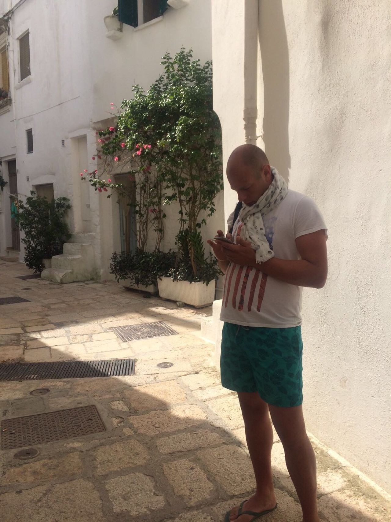 in the old town of Cisternino in Puglia Standing Lifestyles Wireless Technology Real People Full Length One Person Outdoors Day Architecture Gurdu86 Cisternino