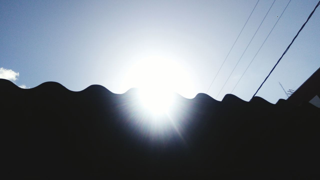 sun, silhouette, sunbeam, lens flare, no people, sunlight, low angle view, nature, sky, beauty in nature, outdoors, clear sky, day