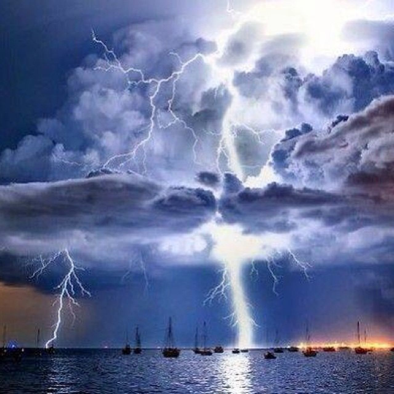 cloud - sky, lightning, power in nature, thunderstorm, water, danger, outdoors, sea, nature, forked lightning, night, sky, no people, storm cloud, nautical vessel, scenics, beauty in nature, horizon over water, cyclone