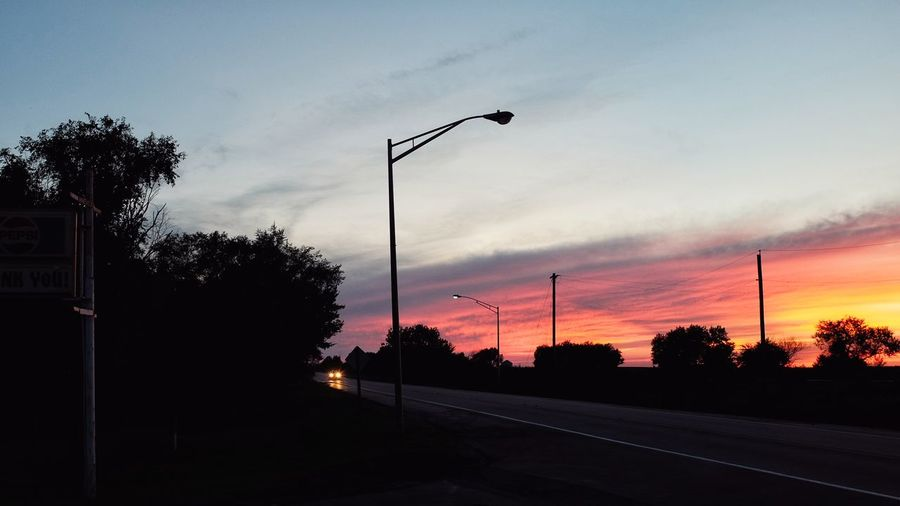 August 2016 Friend, Nebraska 35mm Camera A Day In The Life Camera Work Color Photography Diminishing Perspective Eye For Photography EyeEm Best Shots EyeEm Gallery FUJIFILM X100S Illuminated Landscape My Neighborhood Outdoors Photo Essay Photography Road Rural America Silhouette Small Town America Small Town Stories Street Light Summertime Sunset The Way Forward Tranquil Scene