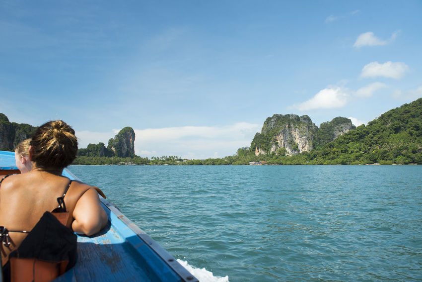 tourist on boat go to railay krabi travel destinations in south of Thailand. Forigners Krabi Thailand Lady People Watching Sunlight Tourist Attraction  Andaman Sea Beauty In Nature Day Landscape Nature Outdoors Railay Beach Rayavadee Sea Sunny Day Tourist Destination Tourist Place Tropical Climate Tropical Tree Water