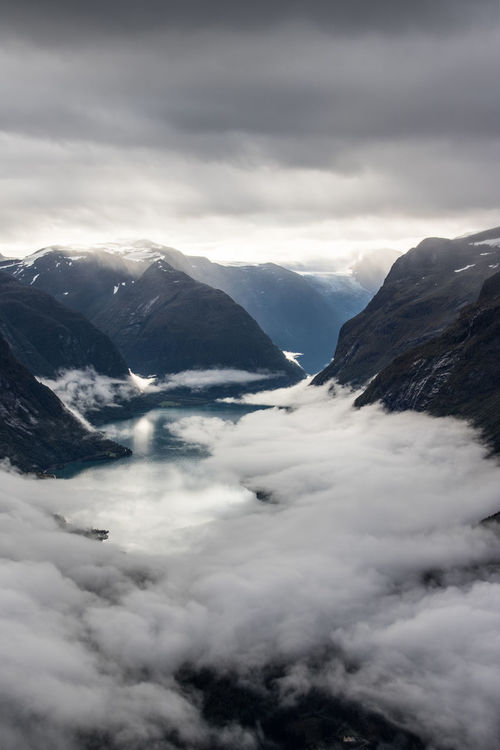 Fjord in Norway Norway Sunlight Sun Cloud - Sky Cloud Water Glacier Hiking Loen Loen Skylift Mountain Cloud - Sky Snow Cold Temperature Winter No People Tranquility Scenics Landscape Nature Outdoors Beauty In Nature Mountain Range Travel Destinations