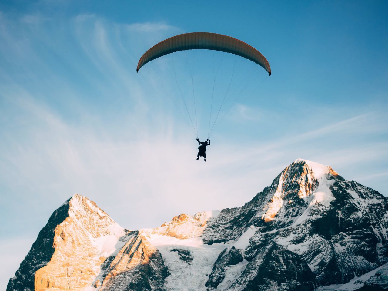 Paragliding Adventure Mountain Extreme Sports One Person Mountain Range Unrecognizable Person Flying Parachute Leisure Activity Real People Exhilaration Beauty In Nature Transportation Nature Full Length Outdoors Low Angle View Sport Day Sky Switzerland VSCO Fresh On Market 2017