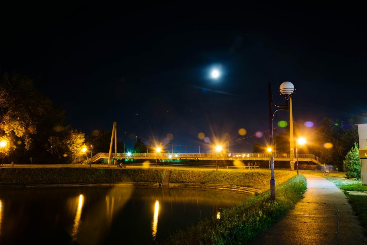 Street Light Night Illuminated Water Reflection City Sky Long Exposure Neon Color Urban Photography River Bank And Reflection In Water Nightphotography City Lights Bridge - Man Made Structure Built Structure Dry Bridge Architecturephotography Cityscape Zrenjanin Architectural Detail Nikonphotography