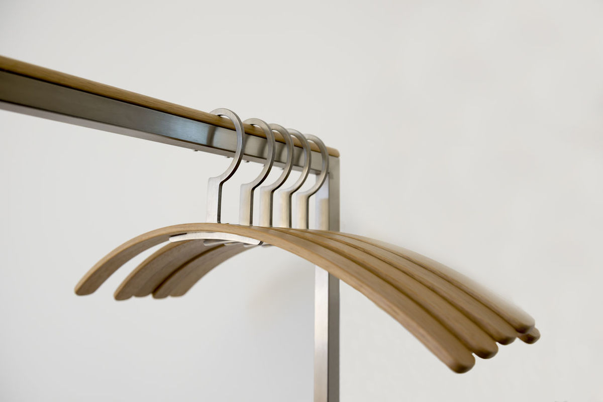 Clothes hangers Close-up Clothes Hanger Coat Hanger Coathanger Day Hanger Indoors  Metal Modern No People Objects Part Of Rack Textile Design Textile Industry Wall - Building Feature White Background Wood - Material