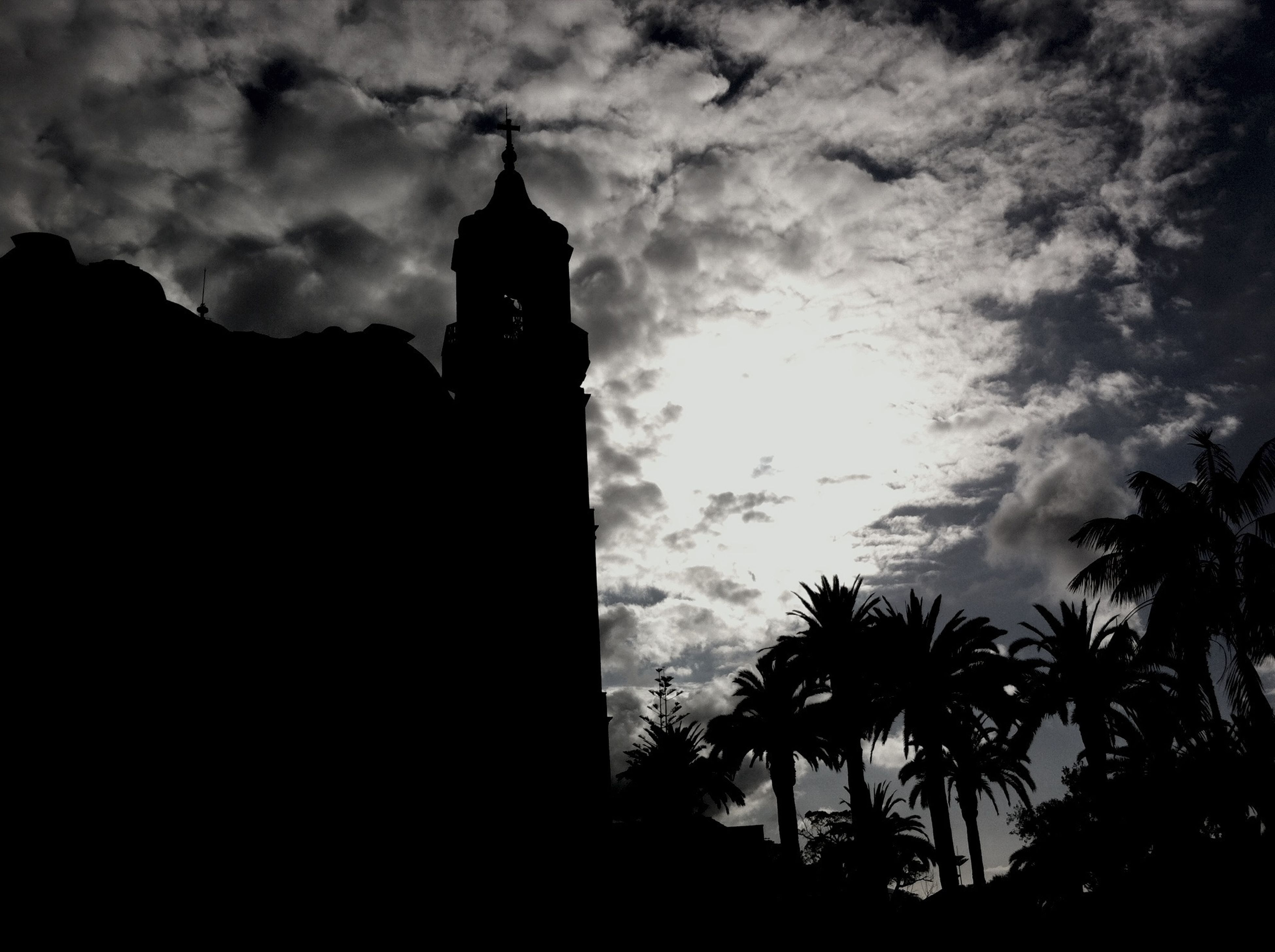 sky, silhouette, architecture, low angle view, built structure, building exterior, cloud - sky, cloudy, tree, cloud, tower, dusk, religion, church, outdoors, spirituality, nature, no people, outline