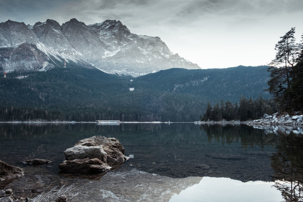 """Perhaps the truth depends on a walk around the lake."" – Wallace Stevens Location: Eibsee, Germany Equipment: Fujifilm X-T2 + XF18-55 Alpen Alps Beauty In Nature Cloud - Sky Day Deutschland Eibsee Fuji Fujifilm Germany Lake Landscape Mountain Mountain Range Nature No People Outdoors Reflection Scenics Sky Snow Tree Water Winter Zugspitze"