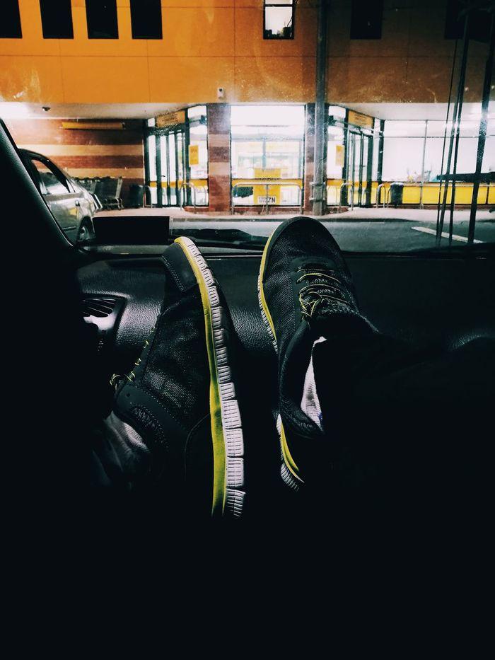 Waiting in the supermarket / Esperando en el supermercado. Waiting Supermarket Shoes Night In The Car Relax Feet Built Structure Architecture No People Enjoying Urban Illuminated Esperando Supermercado Zapatos Noche En El Carro Tranquilo Pies