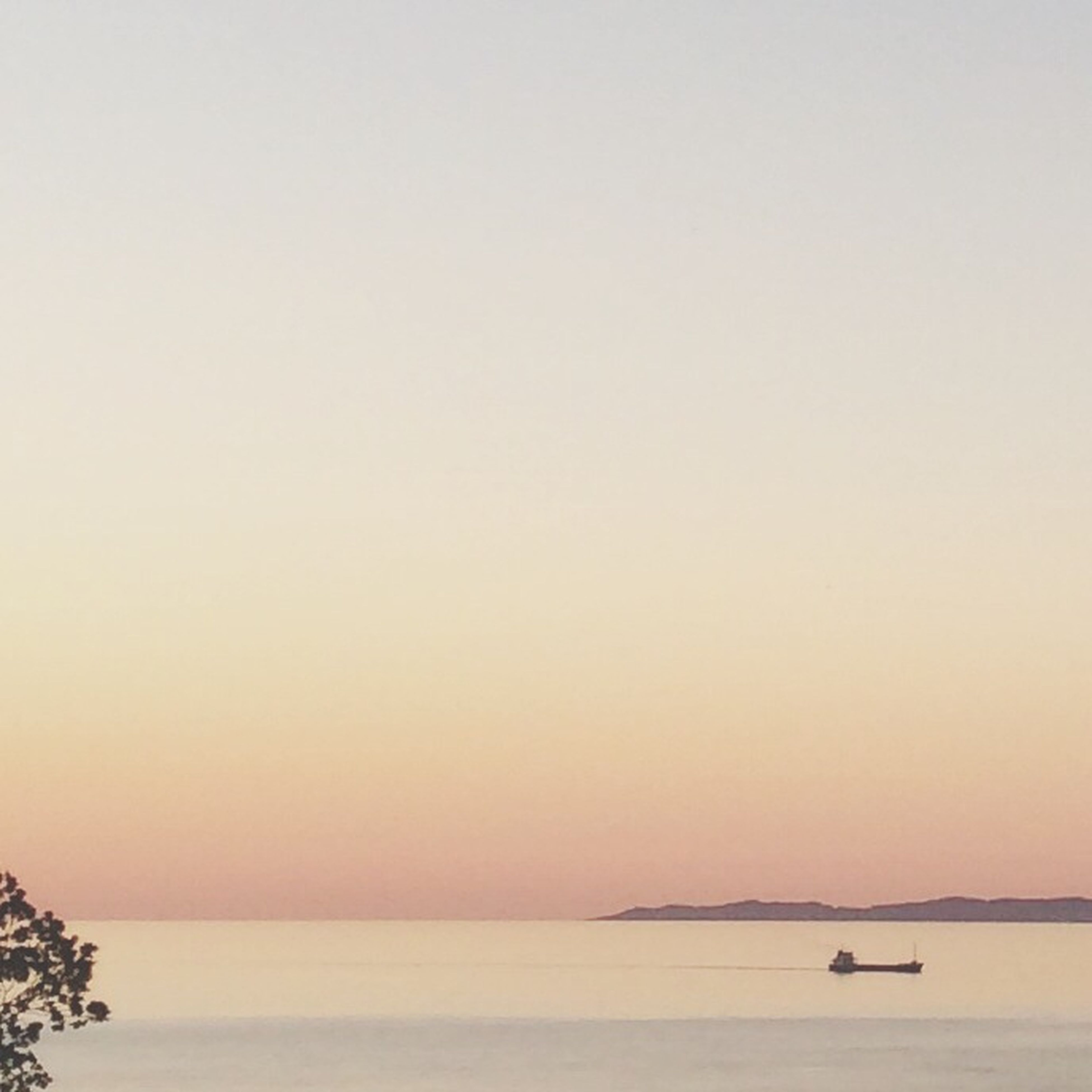 sea, horizon over water, water, sunset, copy space, tranquil scene, scenics, clear sky, tranquility, beauty in nature, orange color, nature, waterfront, idyllic, nautical vessel, silhouette, boat, transportation, seascape, sky