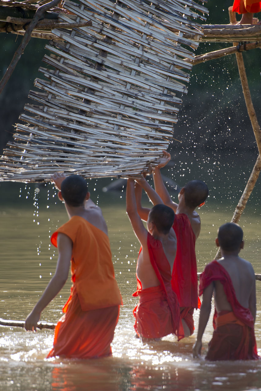 real people, men, cultures, tradition, working, women, religion, occupation, togetherness, lifestyles, spirituality, water, outdoors, day, people