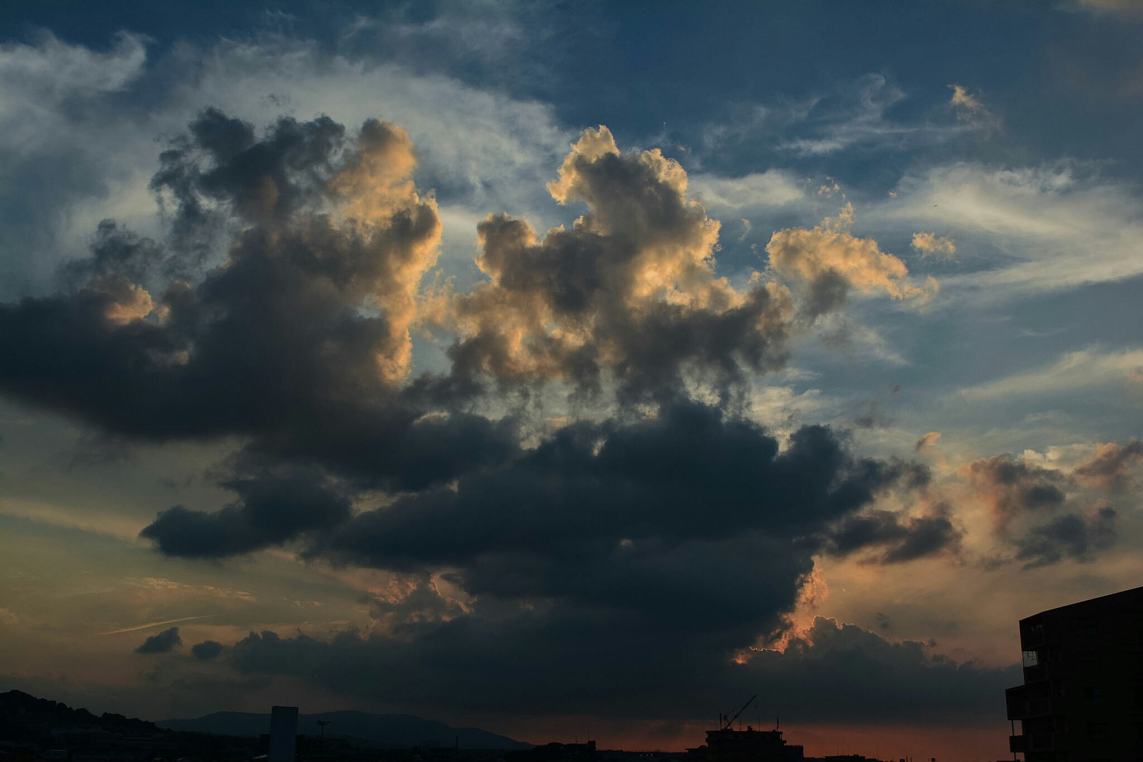 sky, cloud - sky, dramatic sky, beauty in nature, nature, sunset, no people, low angle view, scenics, silhouette, outdoors, tranquility, storm cloud, architecture, day