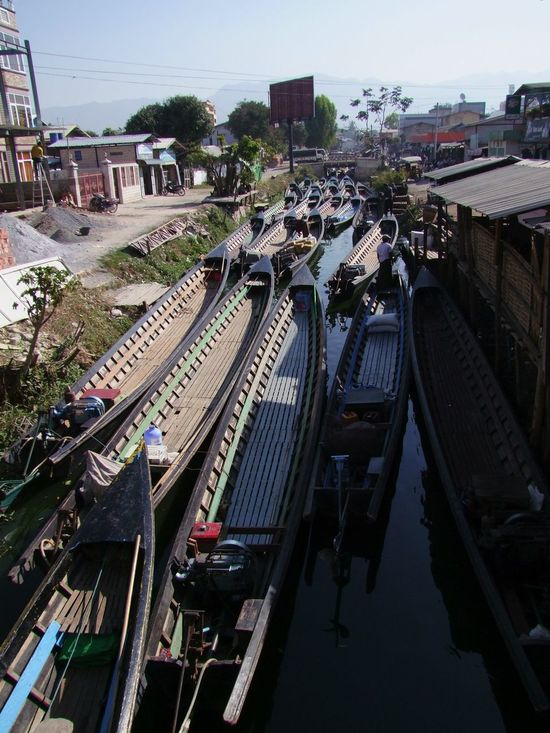 Narrow Boats Blocking the Canal Blue Sky Boats Buildings Calm Canal Composition Empty Boats Empty Narrow Boats Full Frame Moored Boats Myanmar Narrow Boats No Movement No People Nyaung Shwe Outdoor Photography Sunlight And Shade Tourism Town Traffic Jam Tranquility Travel Destination Trees Unusual Water