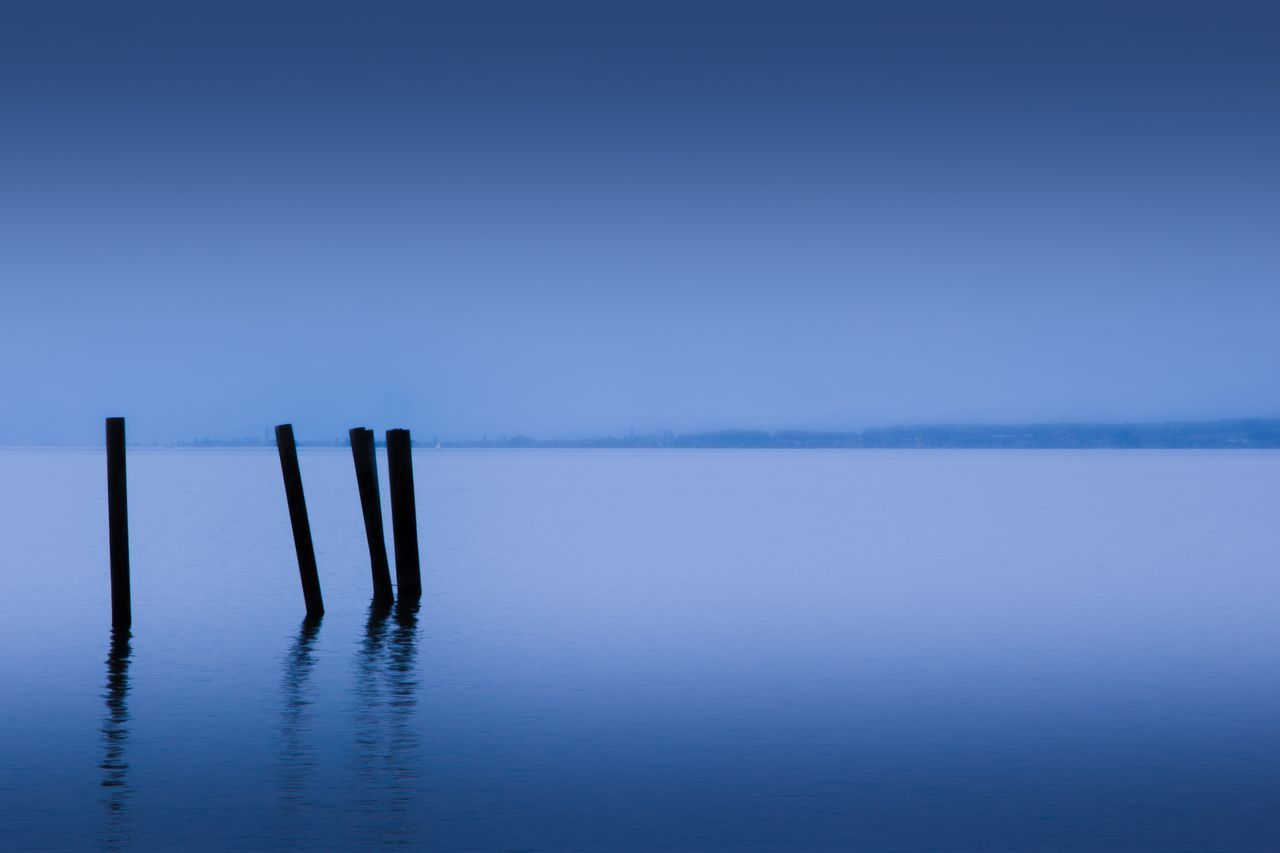 Blue sea Tranquility Tranquil Scene Water Reflection No People Wooden Post Outdoors Scenics Blue Beauty In Nature Nature Lake Day Sky Ladyphotographerofthemonth Lake Constance Pile Tranquility Meditation Blue Wave Blue Sea Blue Sky Relaxing Moments Relaxing Tranquil Nature Scene