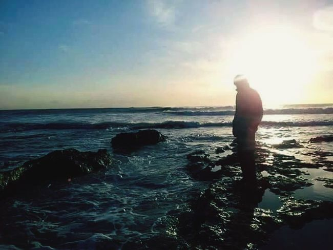 Sea One Person Silhouette Horizon Over Water Beach Standing Sky Tranquil Scene Nature Sunset Rear View Water Full Length Tranquility Beauty In Nature Scenics Outdoors Wave Day People