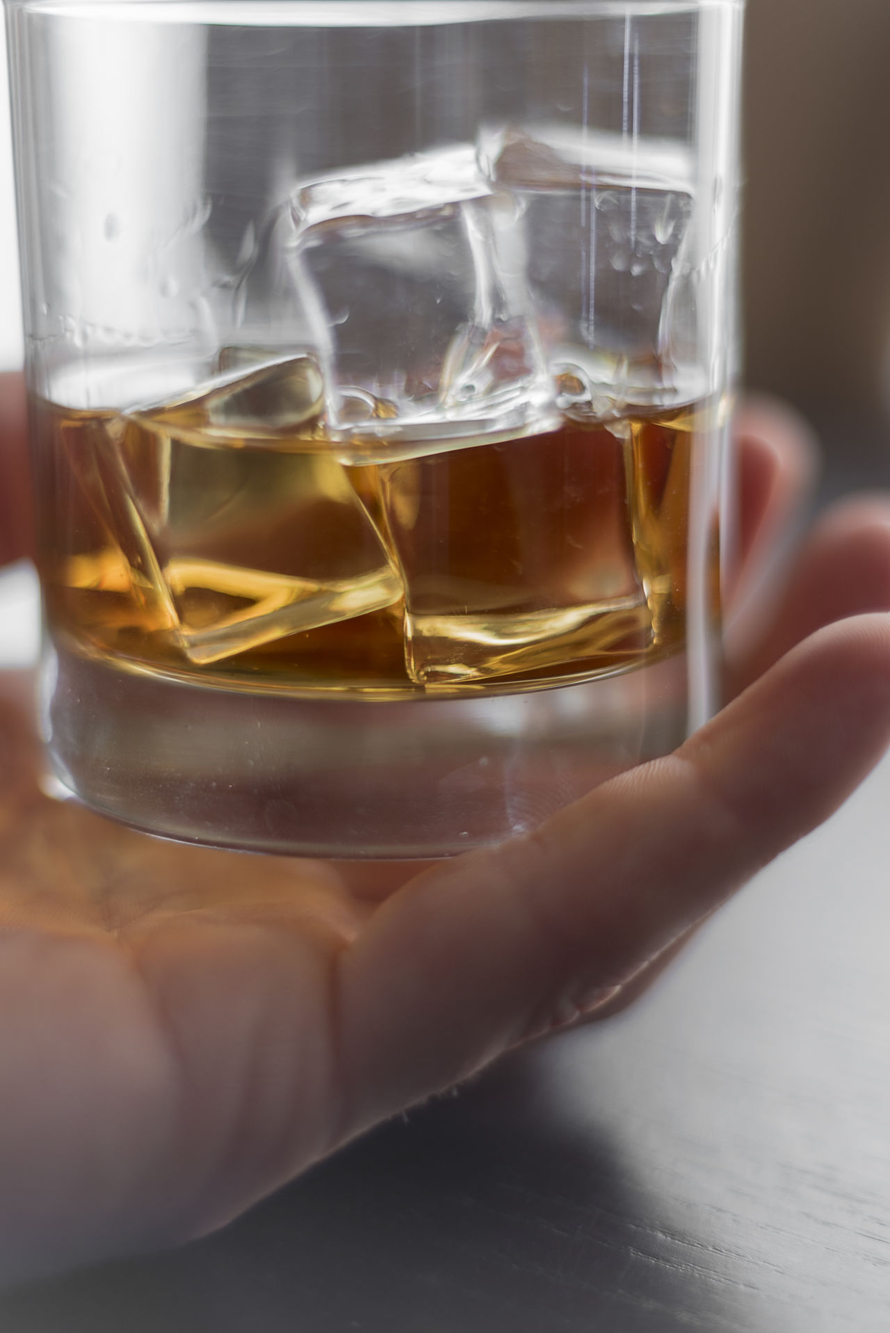 Macro whiskey in hand Adult Adults Only Alcohol Beverage Brandy Celebration Close-up Day Dram Drink Drinking Glass Food And Drink Freshness Holding Human Body Part Human Hand One Person Only Women People Refreshment Snifter Whiskey Women