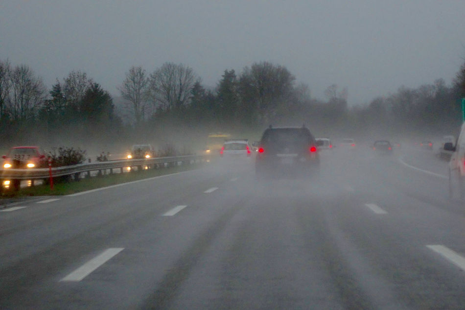 Bad weather on the highway in the Rhine Valley, Switzerland. Bad Weather Car Highway Illuminated Land Vehicle Mode Of Transport No People On The Move Outdoors Red Rheine Valley Road Road Marking Street Switzerland The Way Forward Transportation Travel Tree Weather