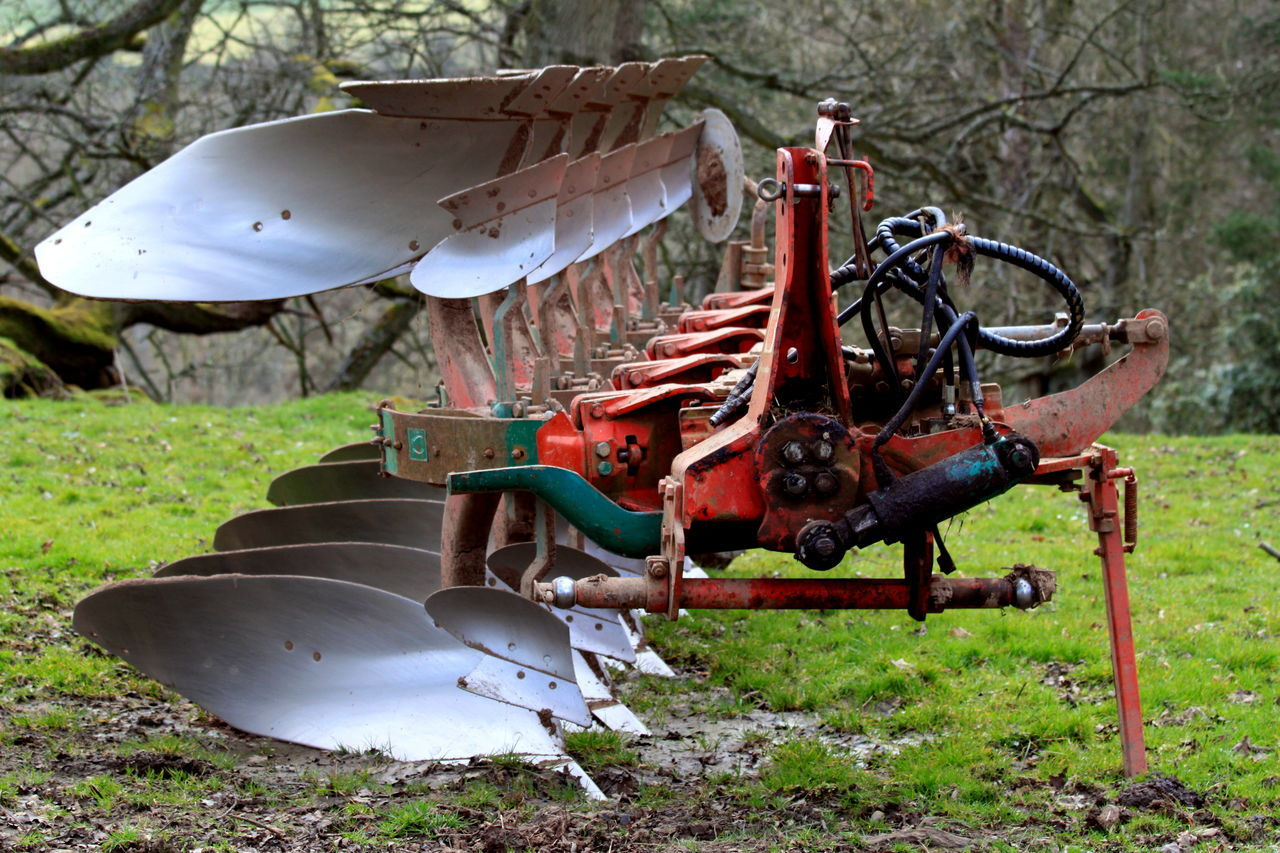 Agricultural Machinery On Grassy Area