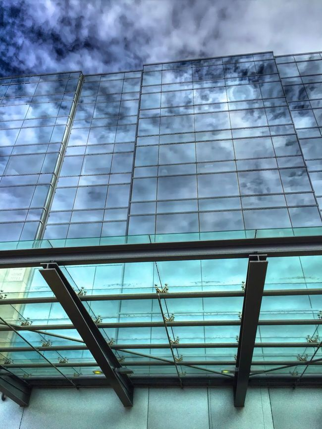 """""""The Continuum"""" Dramatic clouds infinitely reflected in the glass of modern architecture. Glass Glassreflections Reflection Window Reflections Urban Reflections Reflections Architecture_collection Glassarchitecture Achitecture"""