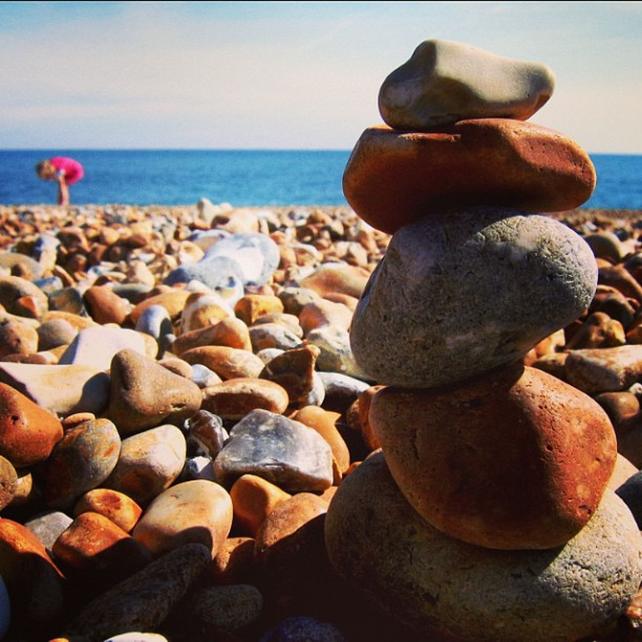 Beach Hasting Pebbles Rocks sea sun sunshine uk rockart balanced igadict igdaily instadaily canon a95 red