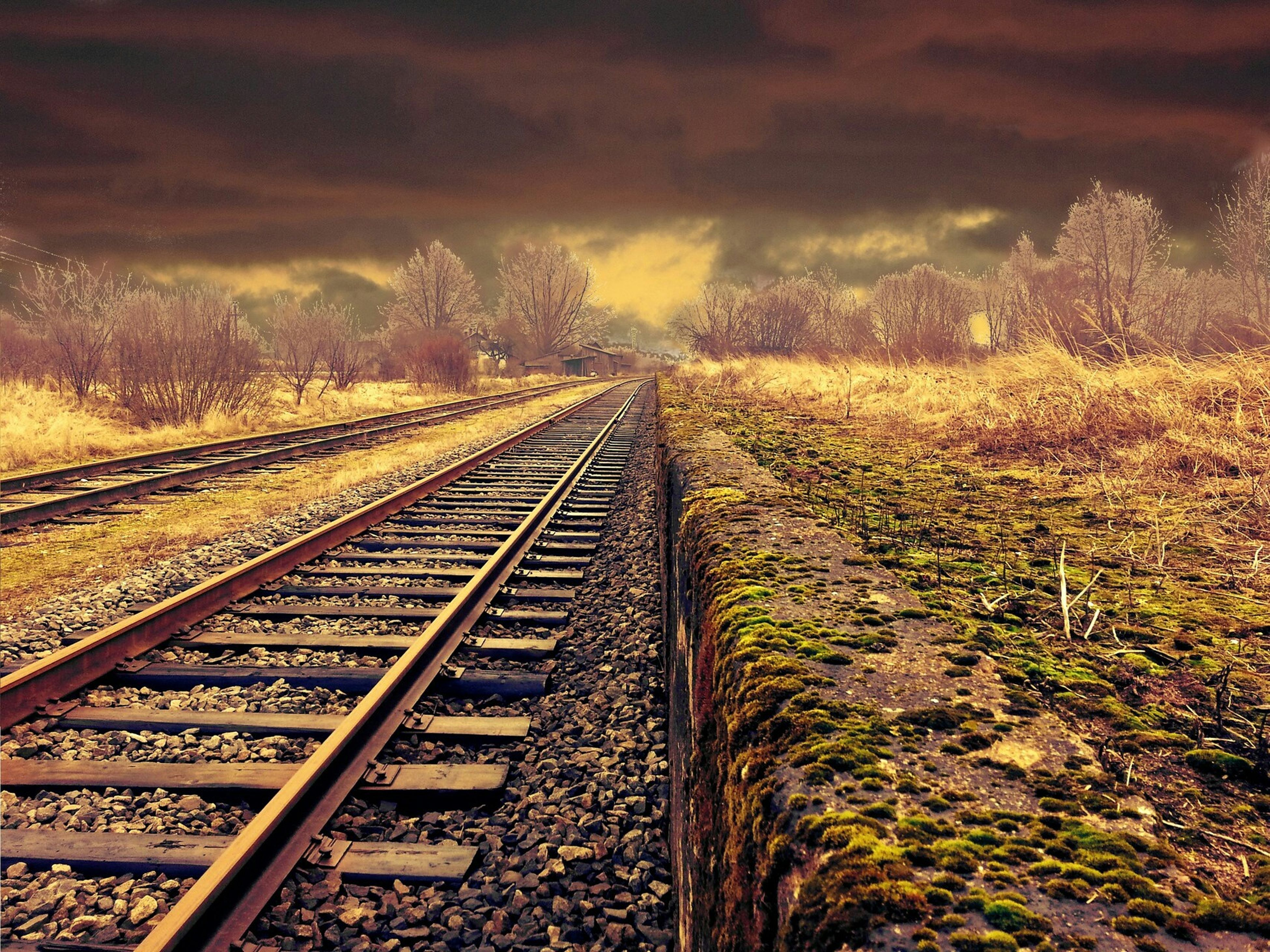 railroad track, rail transportation, the way forward, diminishing perspective, vanishing point, transportation, sky, railway track, tree, cloud - sky, straight, landscape, nature, tranquility, public transportation, no people, tranquil scene, outdoors, day, long