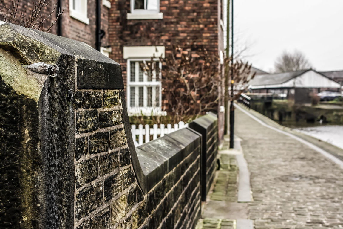 Leeds Liverpool Canal Wall Wigan Architecture Building Exterior Built Structure Close-up Cobblestone Day Focus On Foreground House No People Outdoors Residential Building Sky Snow Towpath Tree