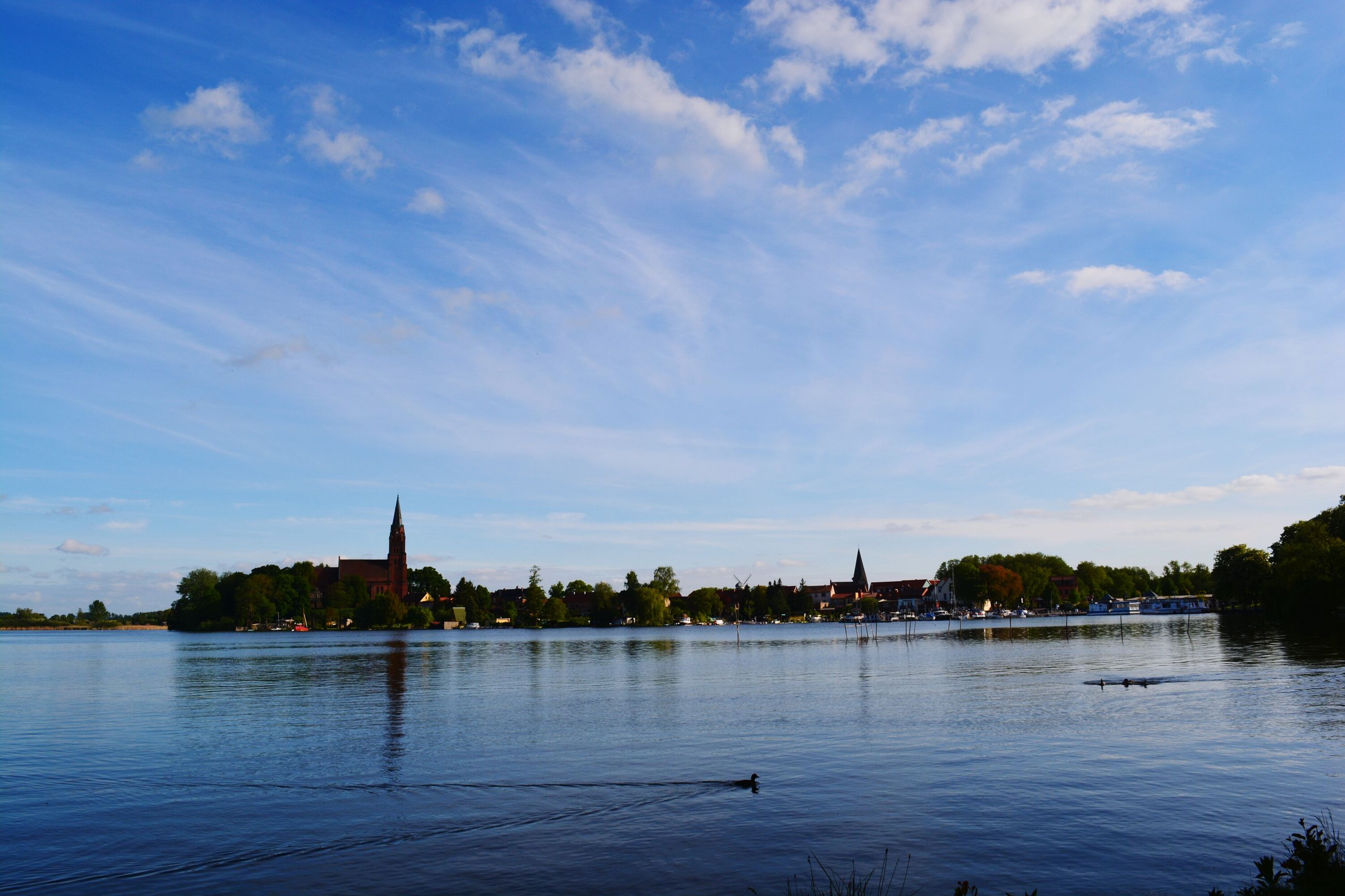 water, sky, built structure, architecture, cloud - sky, cloud, tranquility, scenics, blue, tranquil scene, nature, outdoors, beauty in nature, no people, cloudy, rippled, idyllic, calm, day, travel destinations