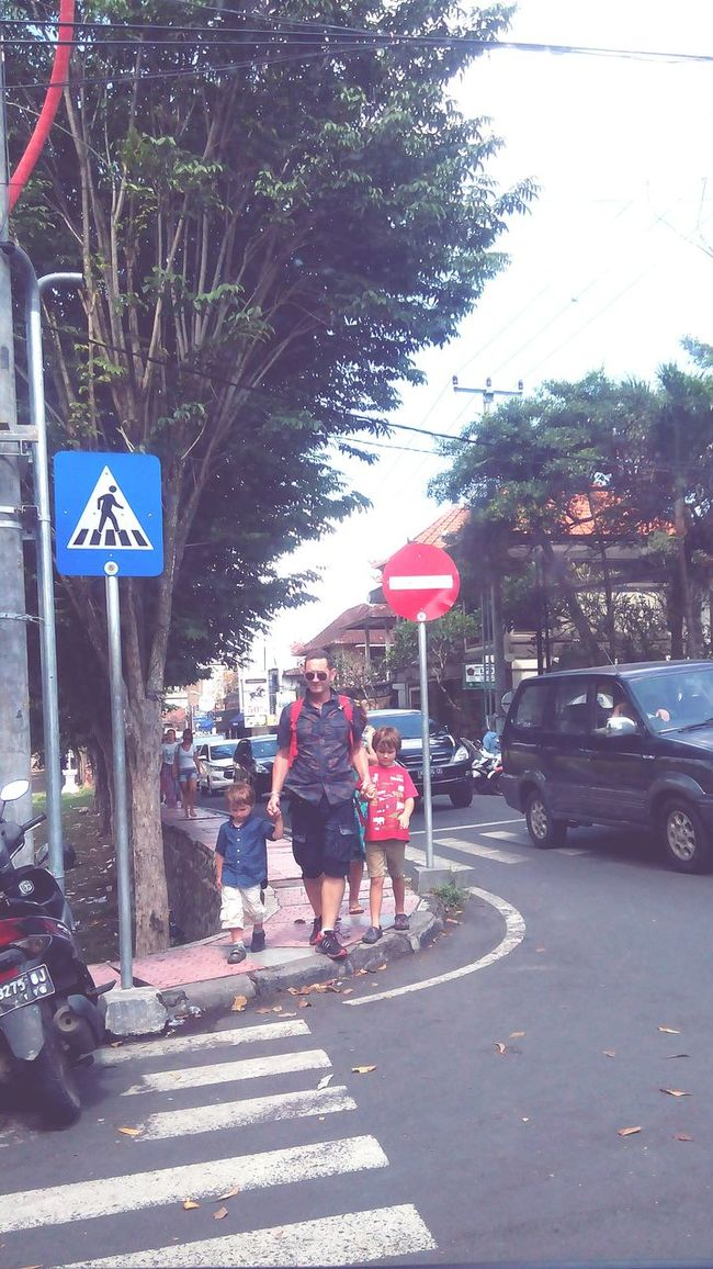 Fatherhood Moments by September 8 2016Transportation Car Road Street Land Vehicle Mode Of Transport Road Sign Walking Tree Zebra Crossing On The Move Communication Road Signal Day Outdoors Person City Life Lens Flare Crosswalk Fatherhood Moments Father's Day FatherSonMoments