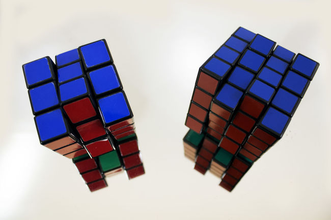 Blue Close Up Cubes Geometric Shape Indoors  Mirror Mirror Effect Mirror Picture Mirrored Modern Multi Colored New View Red Repetition Rubik's Cube Rubiks Cube Simple Simple Photo Simple Photography Still Life White White Background Wide Angle Wide Angle Lens Wide Angle View