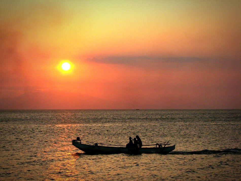 Sunset at sea Sunset Silhouettes Sun Watching The Sunset Sunset Sea Sunlight Silouette & Sky Existential  Water Skylight Silhouette Fisherman EyeEmNewHere Outdoors