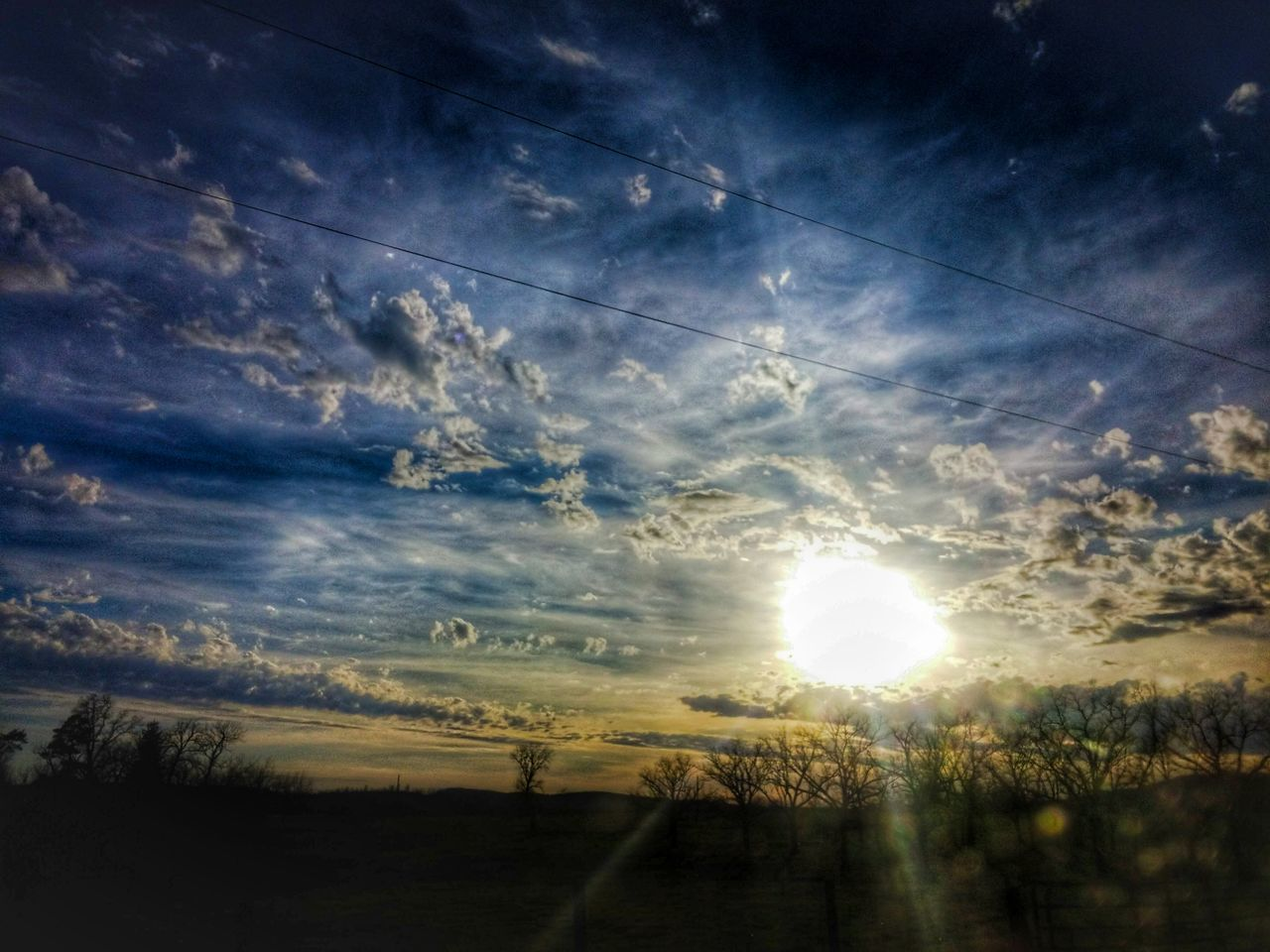 nature, sun, tranquil scene, sky, tranquility, scenics, beauty in nature, no people, sunset, sunlight, silhouette, cloud - sky, outdoors, landscape, tree, day, vapor trail