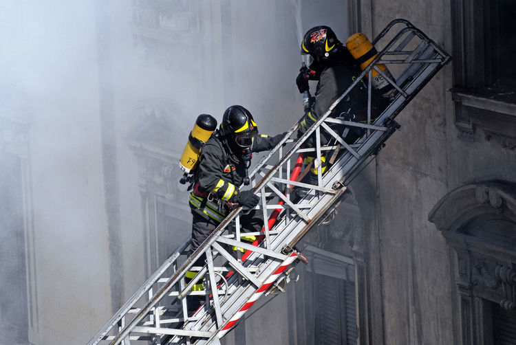 Firemen at work Fire Extinguisher Blaze Casual Clothing Colours Day Fire Firefighters Fireman Job Ladder Leisure Activity Lifestyles Multi Colored Pompieri Smoke Uniform Uniforms Vigili Del Fuoco