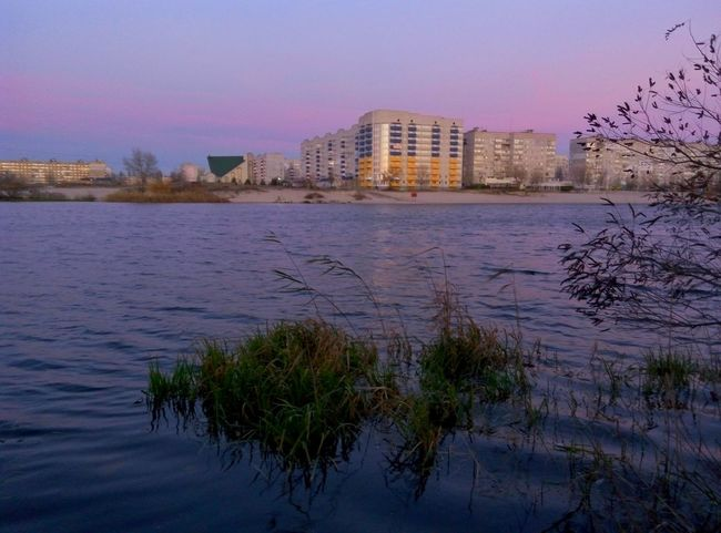 City Building Exterior Architecture Clear Sky Built Structure Apartment Urban Skyline Water Residential Building No People Outdoors Cityscape Sky Day Nature Grass Bush River View Riverside Riverbank Pink Pınky Sundown Sunset Sunrise