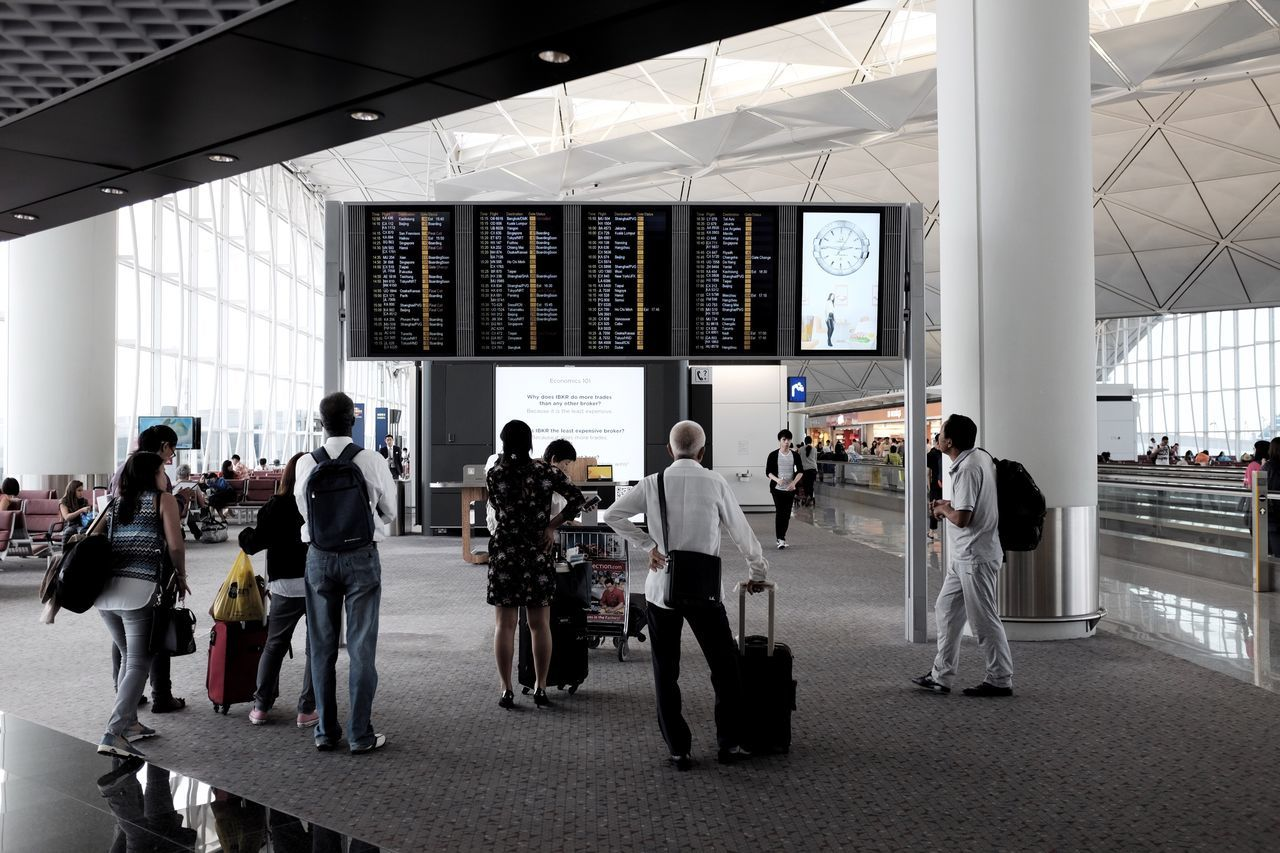 large group of people, real people, men, full length, indoors, architecture, women, built structure, standing, day, airport, city, adult, people