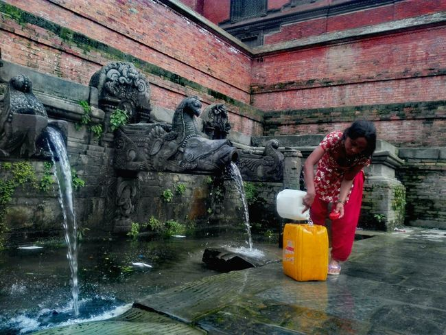 Water Natural Water Ancient Architecture Stone - Object Stone Carving Stone Art Womanportrait Woman In Red Woman Portraiture Taking Photos PhonePhotography Nepal Colors