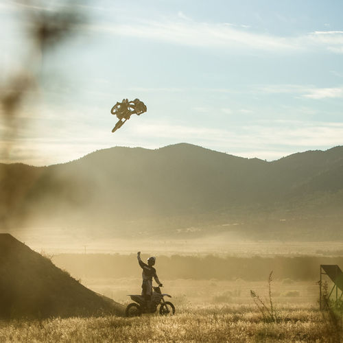 Drake McElroy whips one for Jimmy Hill on the HIll Farm at the Walker Basin in California, USA Adventure Black And White Carefree Drake Mcelroy Early Bird Flying FMX Freestyle Motocross Jimmy Hill Jump Mid-air Mountain Outdoors Sky Whip