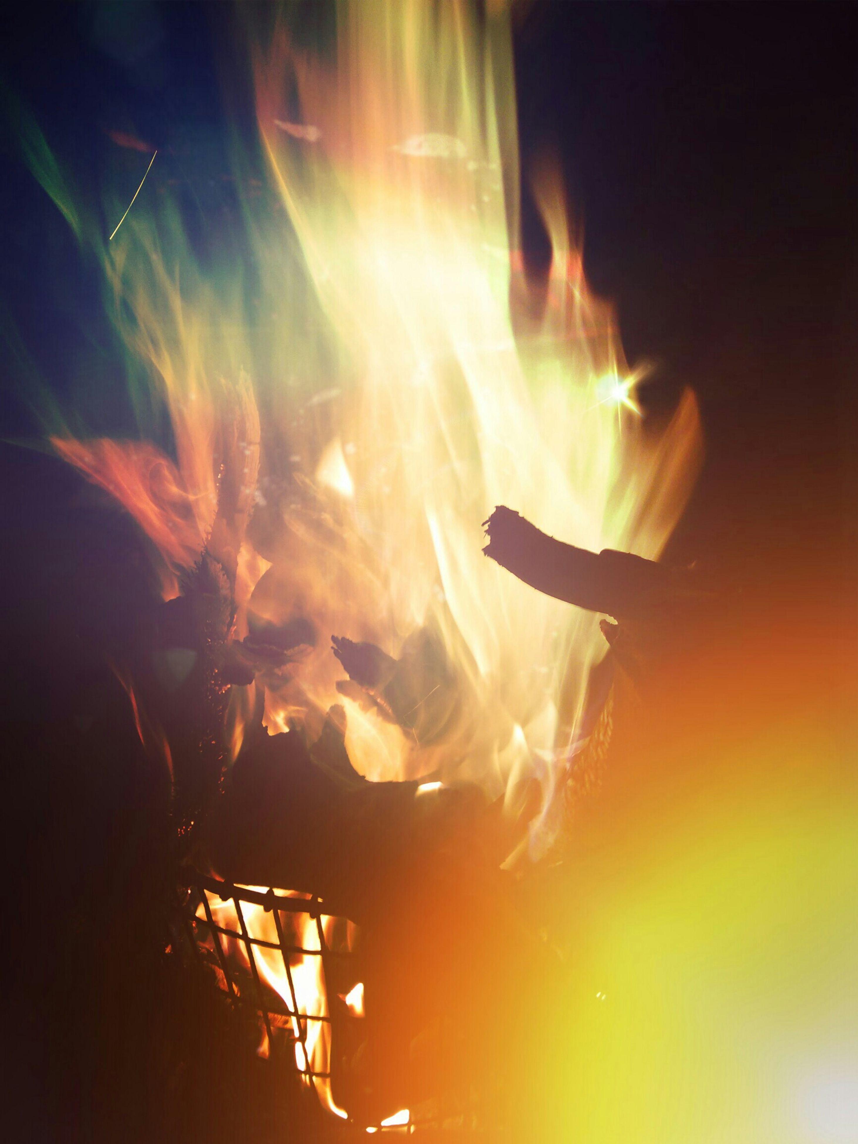 burning, fire - natural phenomenon, flame, heat - temperature, leisure activity, lifestyles, men, orange color, bonfire, glowing, night, fire, motion, silhouette, outdoors, enjoyment, person, light - natural phenomenon