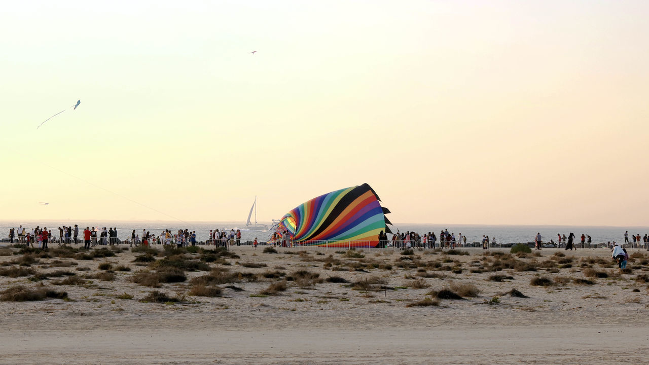 Adult Beach Beach Holiday Day Flying Hot Air Balloon Kite - Toy Leisure Activity Multi Colored Nature Outdoors Parachute People Sand Scenics Sea Sky Summer Travel Destinations Vacations
