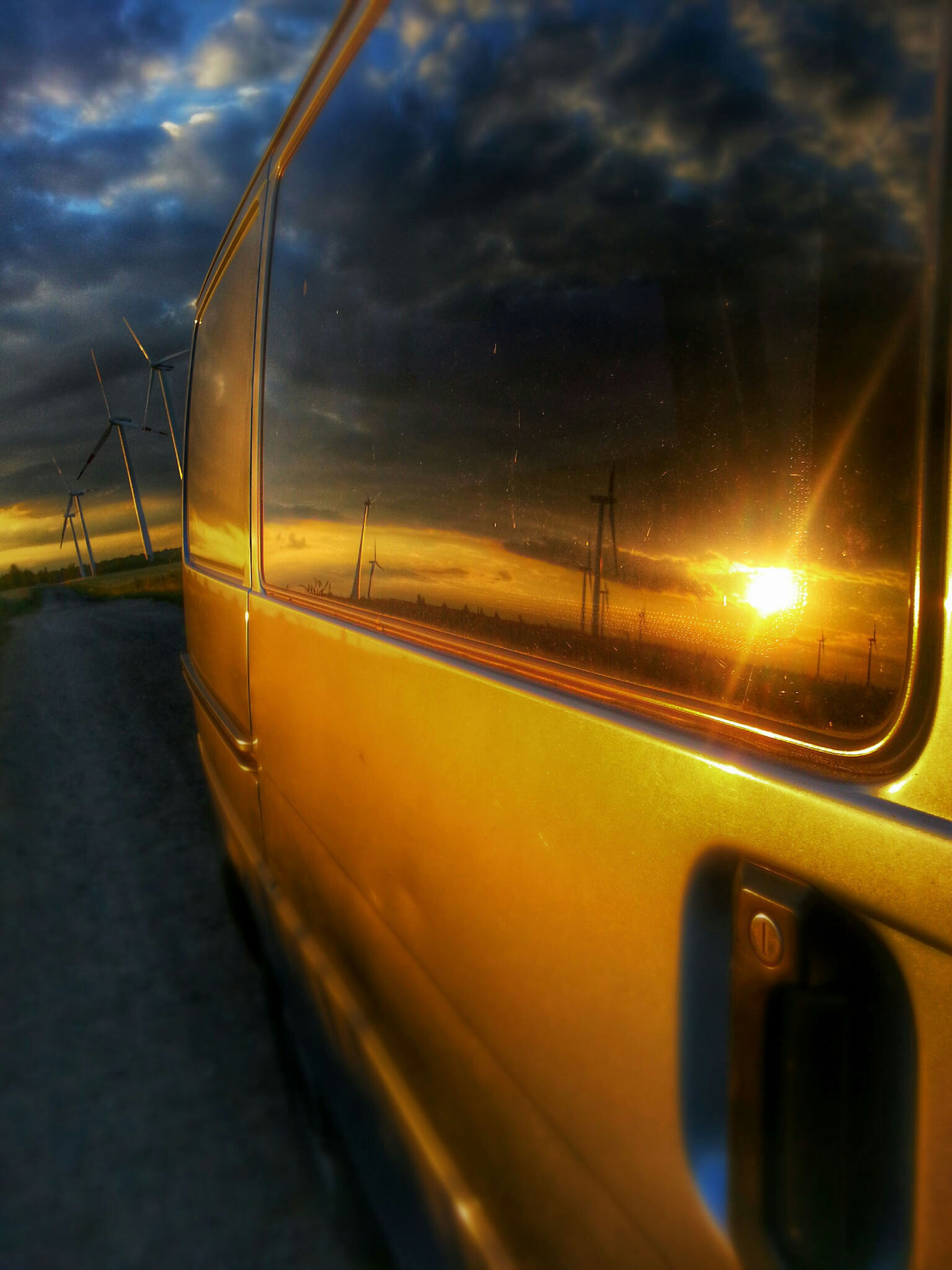 transportation, mode of transport, car, land vehicle, vehicle interior, sky, reflection, sunset, travel, glass - material, cloud - sky, on the move, side-view mirror, road, windshield, transparent, water, part of, cropped, car interior