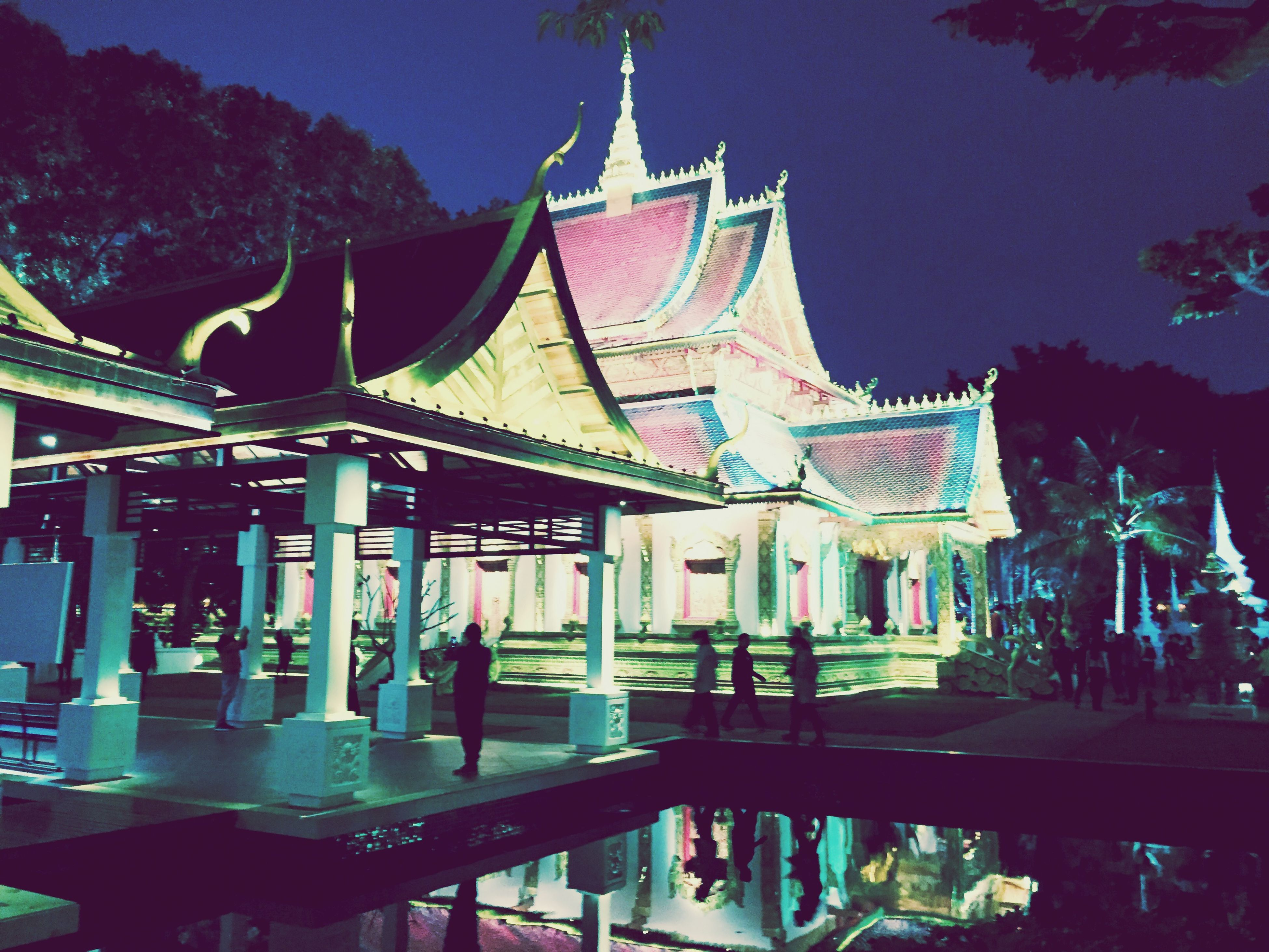 built structure, architecture, religion, place of worship, building exterior, spirituality, temple - building, low angle view, tradition, sky, illuminated, cultures, night, arts culture and entertainment, tree, travel destinations, decoration, famous place, outdoors