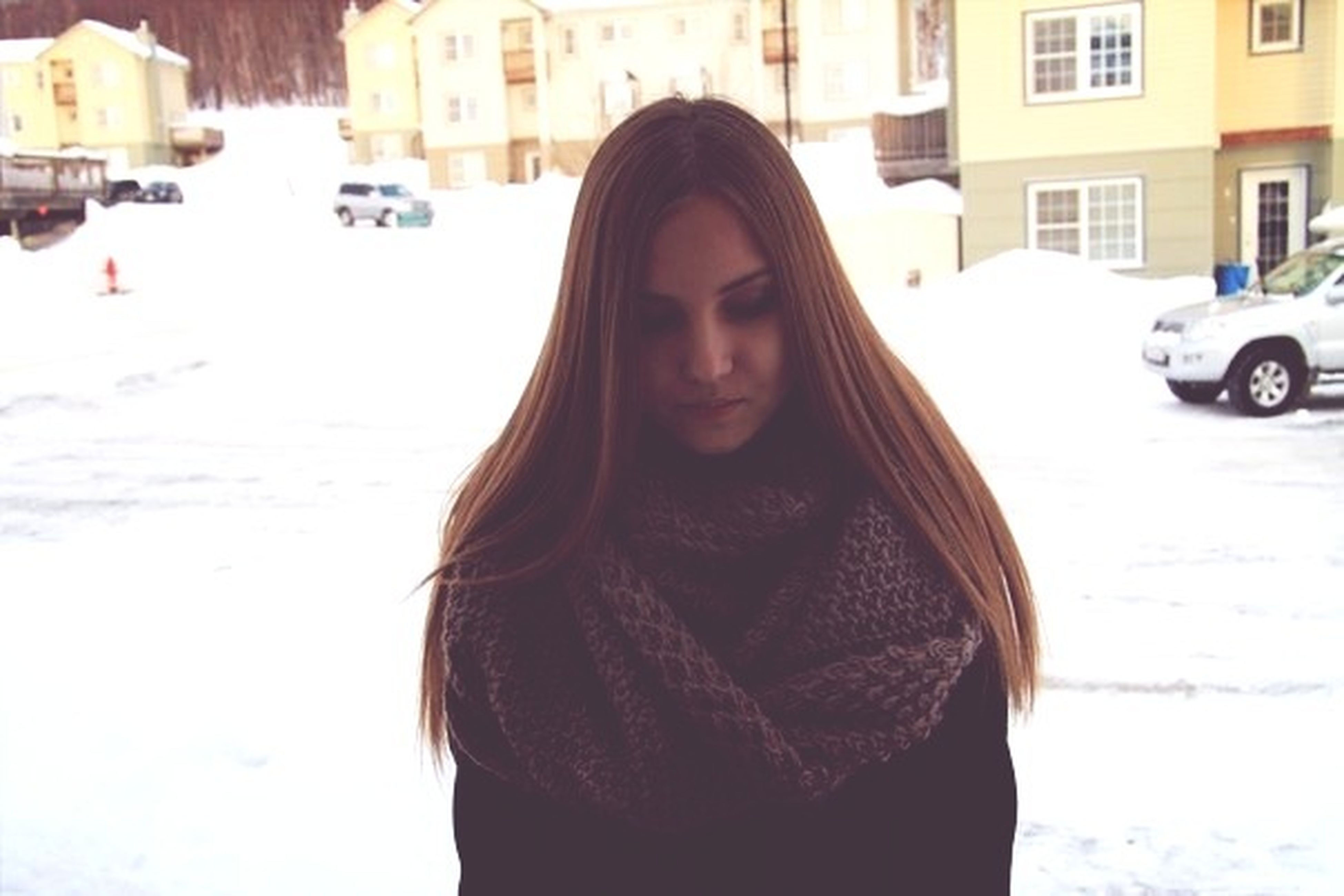 winter, snow, cold temperature, season, building exterior, architecture, lifestyles, warm clothing, weather, built structure, covering, leisure activity, street, young adult, front view, portrait, incidental people, frozen