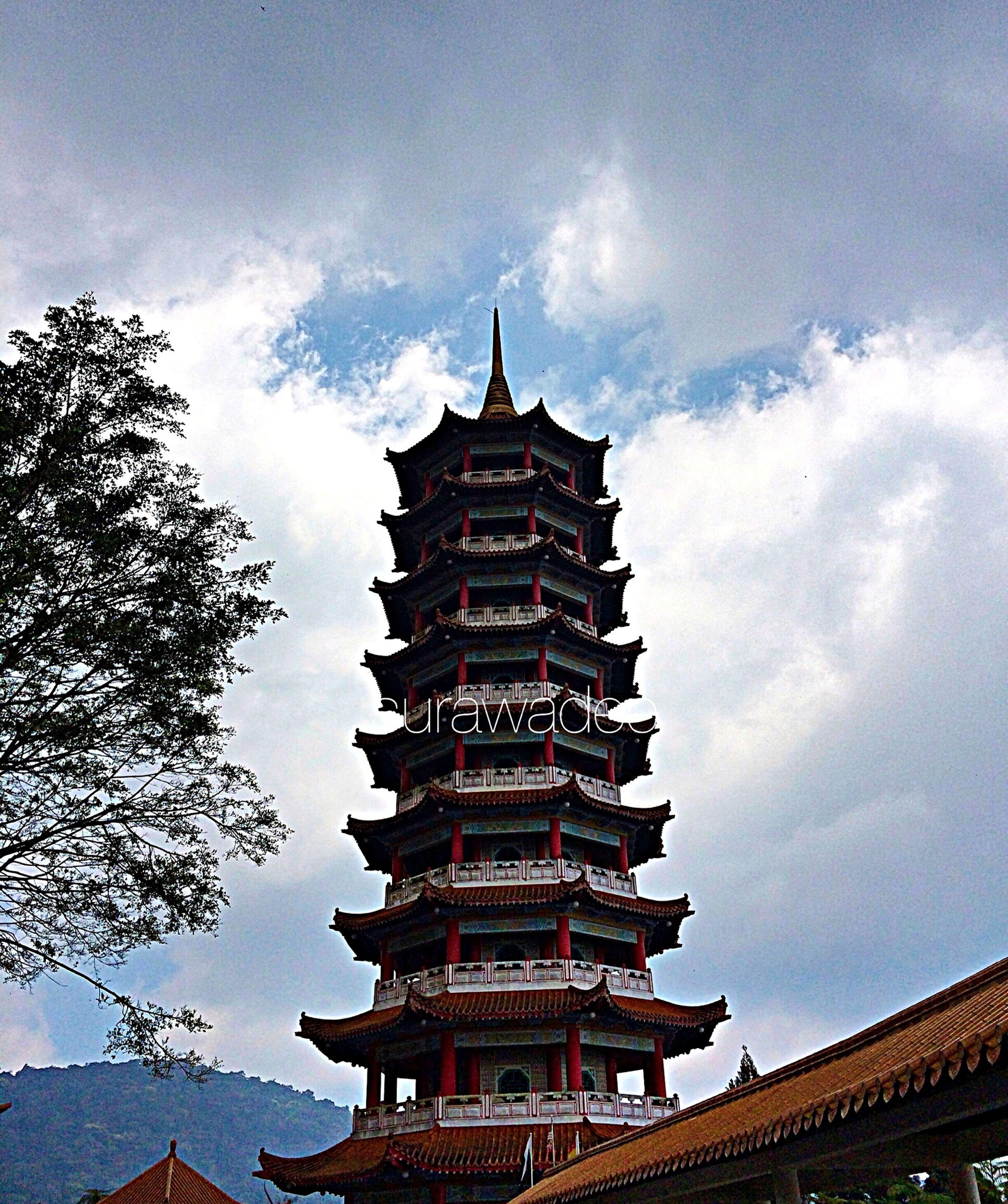 architecture, built structure, building exterior, sky, famous place, temple - building, religion, place of worship, cloud - sky, low angle view, spirituality, travel destinations, tourism, history, temple, travel, cultures, cloud, pagoda