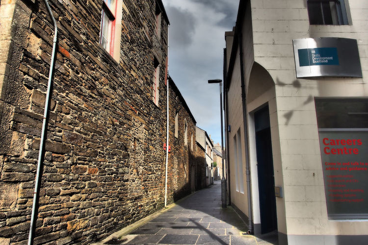 Kirkwall - Orkney Islands, Scotland Architecture Sky Day Outdoors Alley Communication Scottish Highlands No People Remote Location Stone Walls Building Exterior Built Structure Orkney Islands A Taste Of Scotland Bleak And Cold Careers Office