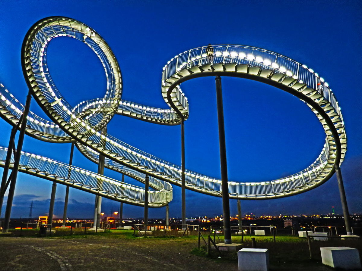 Amusement Park Amusement Park Ride Architecture Arts Culture And Entertainment Blue Building Exterior Built Structure Circle Clear Sky Copy Space Day Famous Place Ferris Wheel Low Angle View Metal Metallic Outdoors Sky Stairways Sunset Silhouettes Tiger & Turtle Tiger And Turtle Tourism Travel Destinations Blue Wave