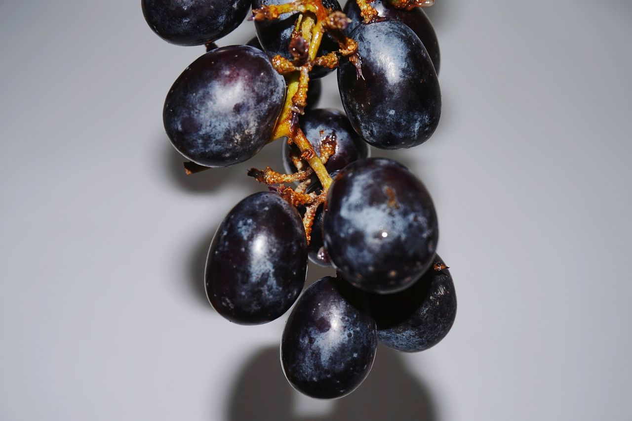 Close-Up Of Grapes Against Wall