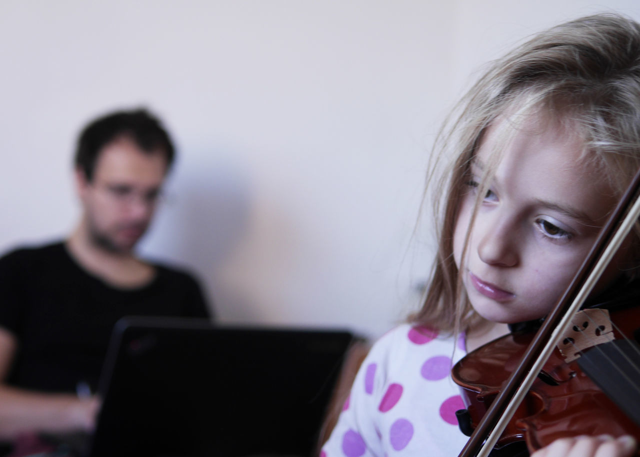 Portrait Of Young Girl Playing Violine