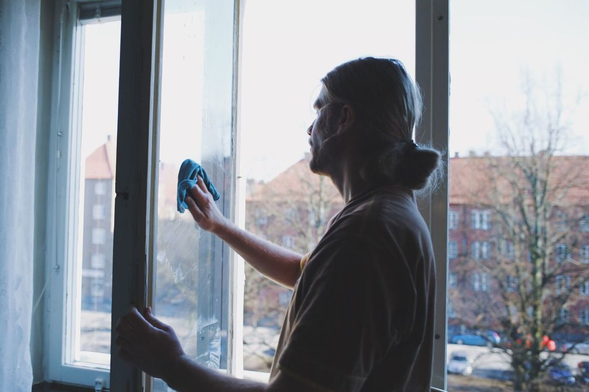 One Person Window Real People Leisure Activity Indoors  Day Holding Portable Information Device Technology People Adult Wash Washing Cleaning Cleaning Windows Springtime Spring Has Arrived Springcleaning Man Real Life Real