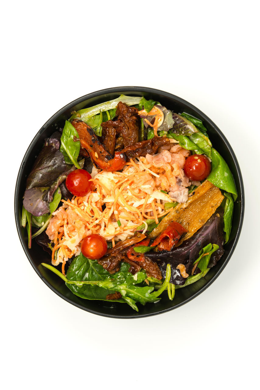 Directly Above Shot Of Food In Bowl Over White Background